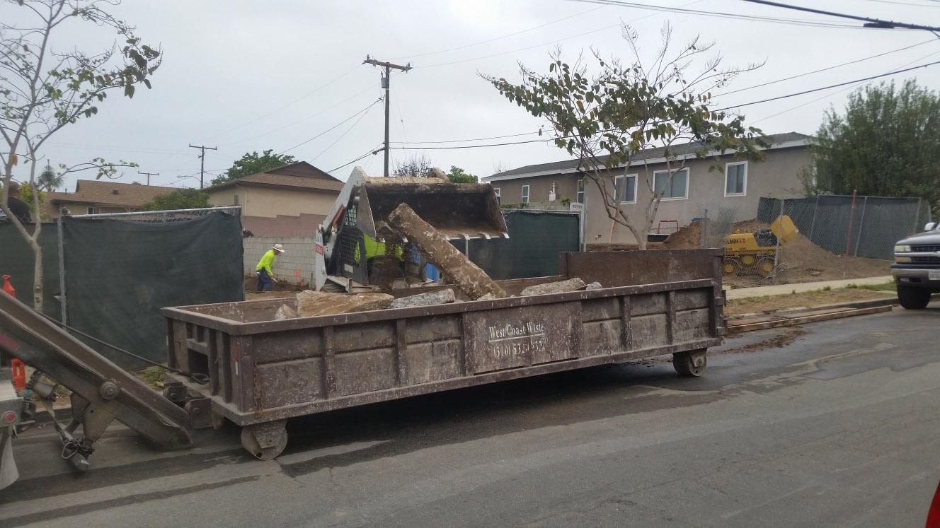 Concrete loaded into lowboy dumpster